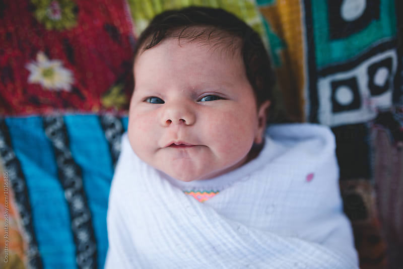 Baby on a patchwork quilt by Courtney Rust for Stocksy United