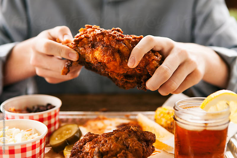 Fried: Man Digging In To Hot Chicken Meal by Sean Locke for Stocksy United