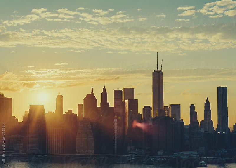 Sunset/Sunflare Over Manhattan Skyline by kelli kim for Stocksy United