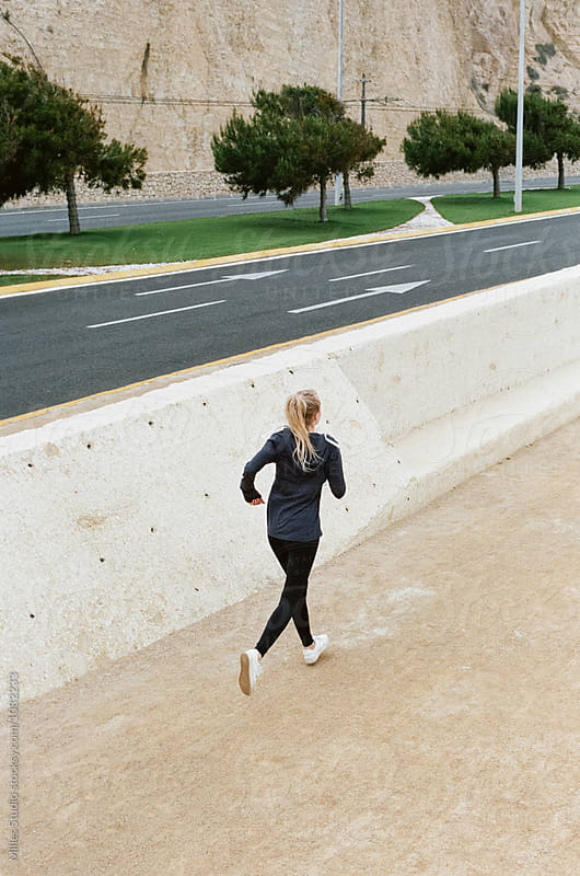 Jogging woman by Milles Studio for Stocksy United