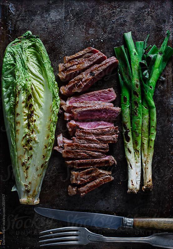 Strip steak. by Darren Muir for Stocksy United