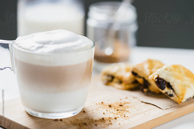 a cup of hot cappuccino and cookies by Juri Pozzi for Stocksy United