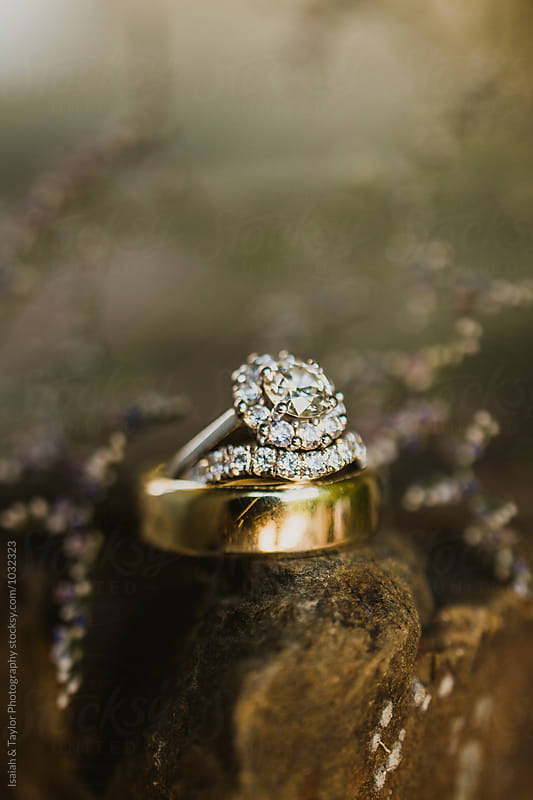 Wedding rings on stone by Isaiah & Taylor Photography for Stocksy United