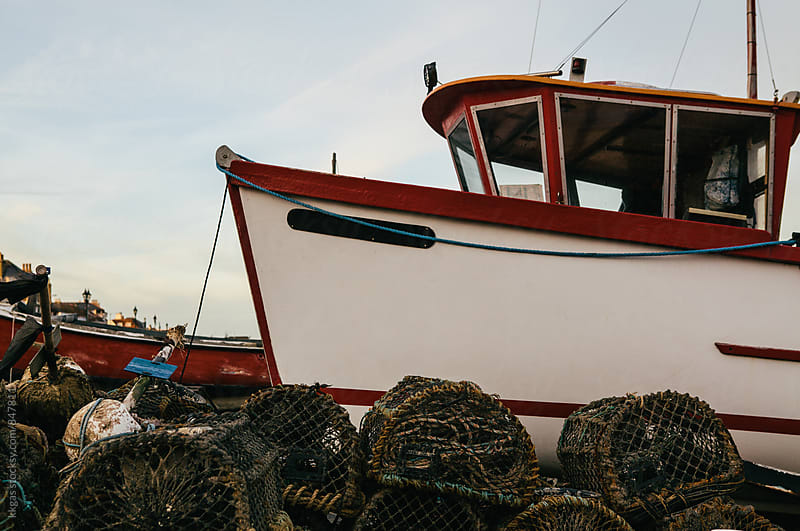 Fishing boat with lobster pots on an empty beach, Kent, UK. by kkgas for Stocksy United