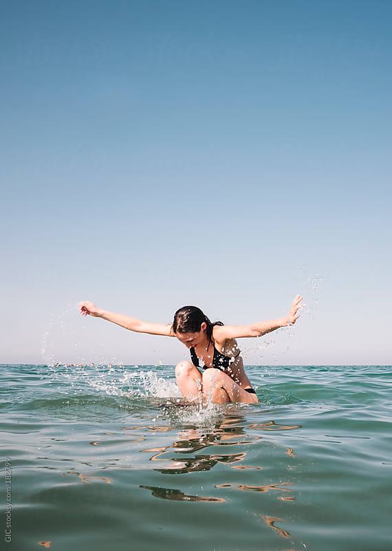 Young Woman having fun in the sea by GIC for Stocksy United