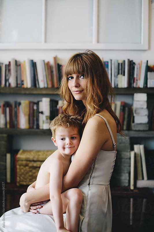 A mother holding her son by Ania Boniecka for Stocksy United