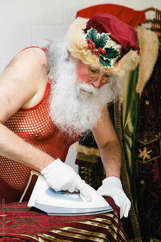 Santa Claus ironing his trousers  by kkgas for Stocksy United