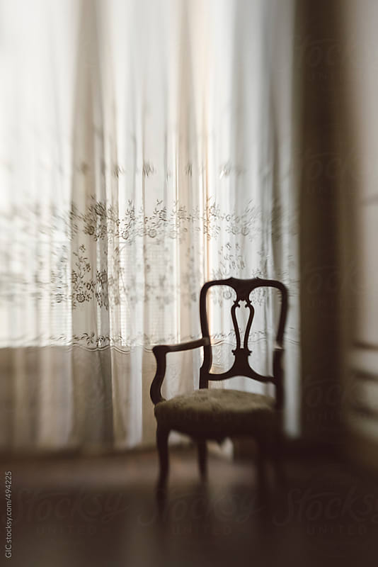 Old chair in the room against a window by GIC for Stocksy United