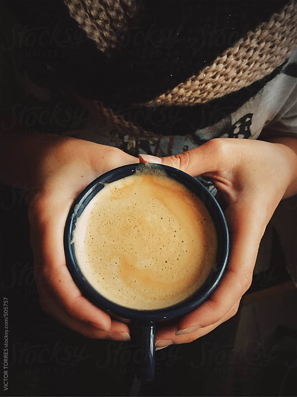 Woman Holding a Warm Cup of Coffee by VICTOR TORRES for Stocksy United
