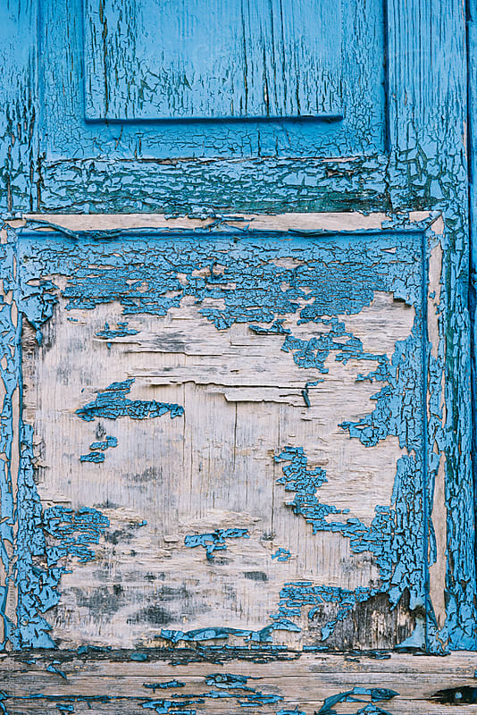 Weathered old blue painted door by Adrian Cotiga for Stocksy United