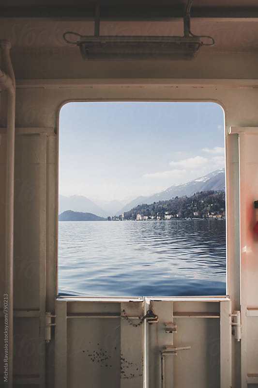 View of the lake from the window of the boat by michela ravasio for Stocksy United