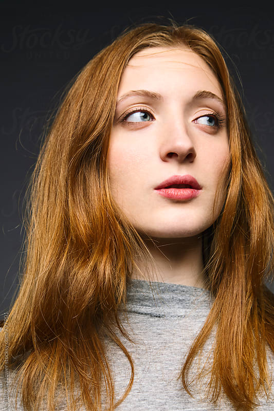 Close-up of beautiful young redheaded woman by T-REX & Flower for Stocksy United