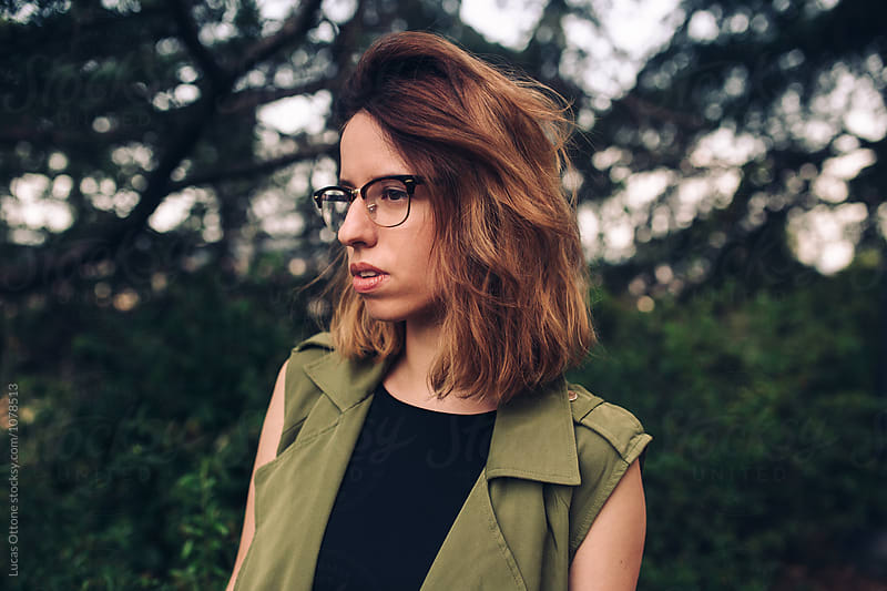 Portrait of a hipster woman on a natural setting by Lucas Ottone for Stocksy United