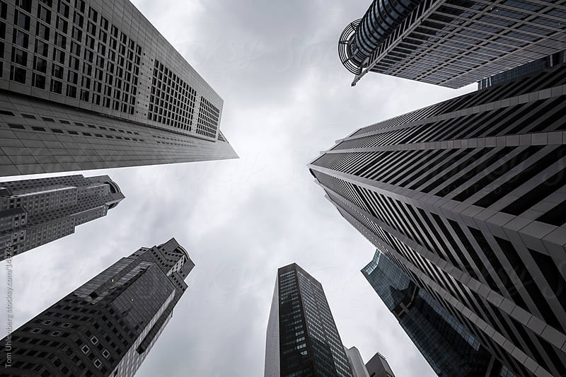 Upward Perspective of Skyscrapers in Downtown Singapore by Tom Uhlenberg for Stocksy United