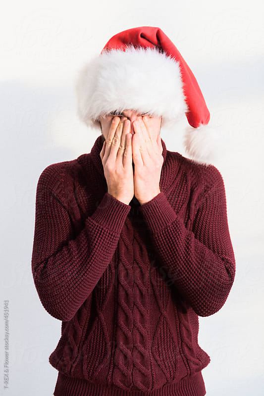 Man wearing Santa Claus hat by T-REX & Flower for Stocksy United
