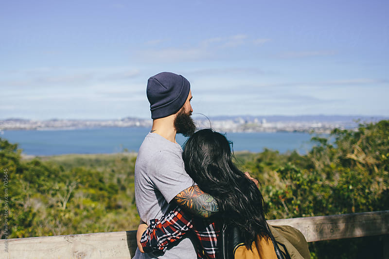 Couple looking at distant city by Andrey Pavlov for Stocksy United
