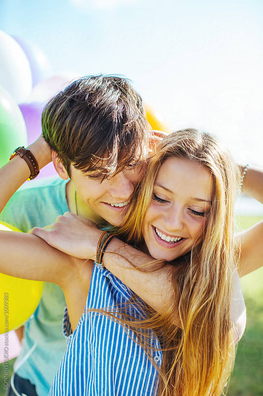 Portrait of a teenage couple having fun on a sunny summer day. by BONNINSTUDIO for Stocksy United
