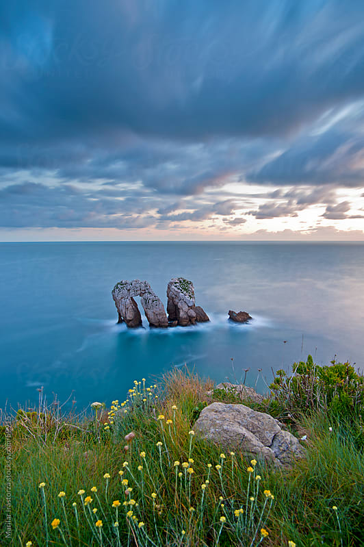 Rock formation in the Bay of Biscay (northern Spain) which looks like gates by Marilar Irastorza for Stocksy United