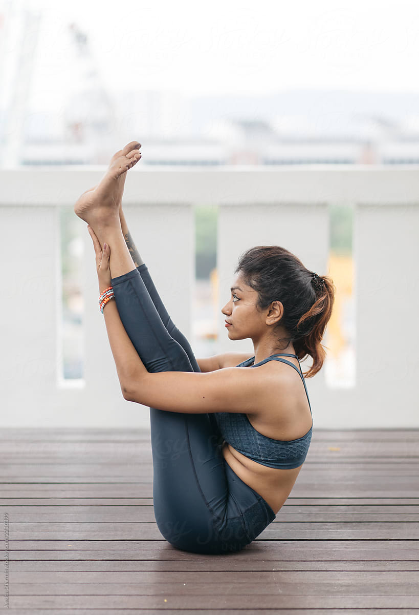 Young Indian Woman Demonstrating Yoga Poses By Jessica Lia Stocksy United