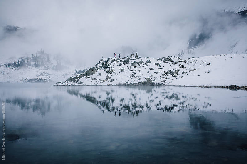 Walking along Tricouni Lake by Michael Overbeck for Stocksy United