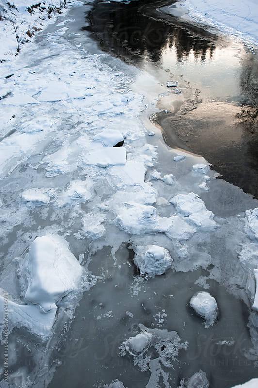 Frozen river in winter by Robert Kohlhuber for Stocksy United