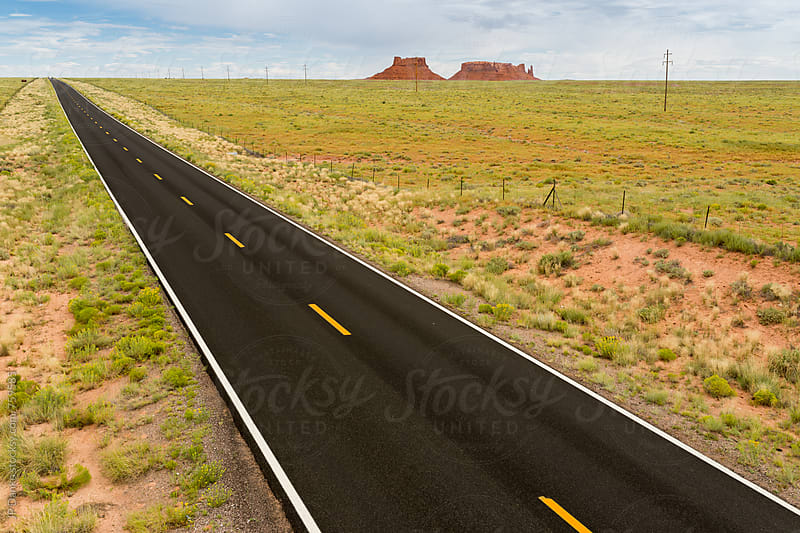 Remote Desolate Newly Paved Asphalt Highway Extending to the Horizon in Arizona. by JP Danko for Stocksy United