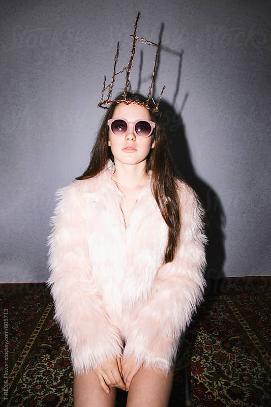 Young woman in fur coat sitting and handmade diadem by Danil Nevsky for Stocksy United