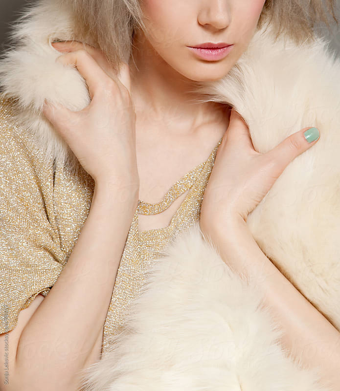 woman wearing fur closeup by Sonja Lekovic for Stocksy United