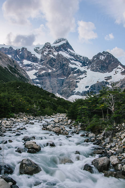 River stream and mountain with snow in Torres del Paine, Chile by Alejandro Moreno de Carlos for Stocksy United
