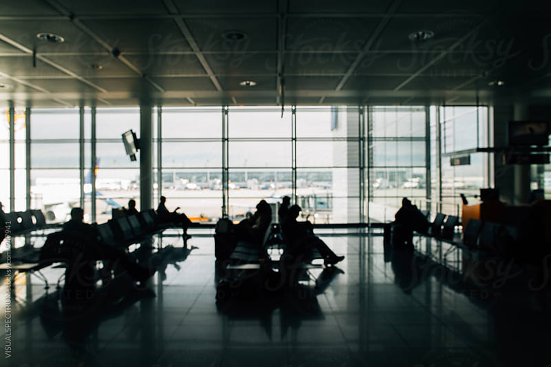 Out of Focus Shot of Passengers Waiting To Board Plane in Modern Airport by Julien L. Balmer for Stocksy United