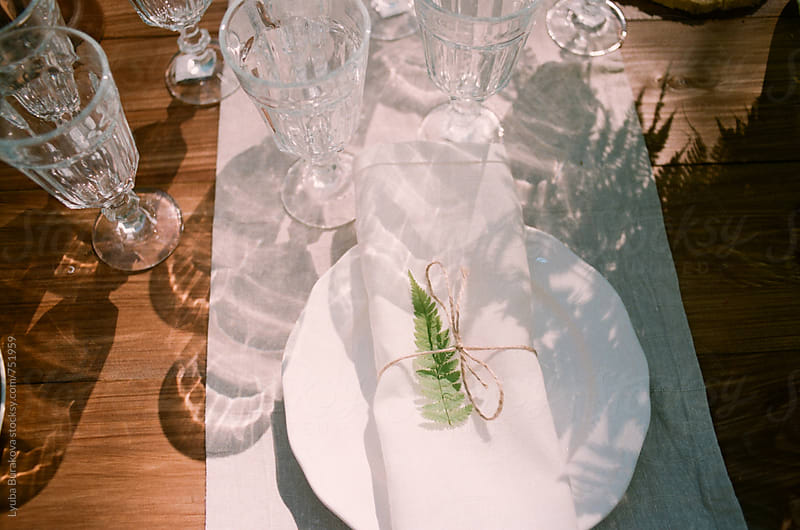 Table setting in process  by Lyuba Burakova for Stocksy United