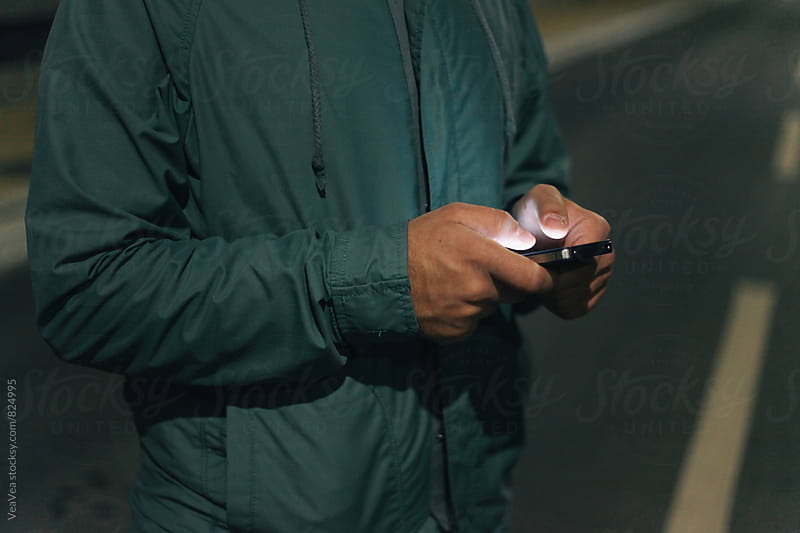 Male hands holding  a mobile phone  by Marija Mandic for Stocksy United