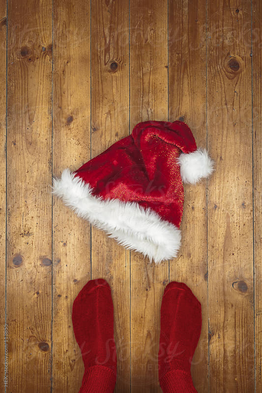 Santa Claus Hat near his Feet by HEX. for Stocksy United