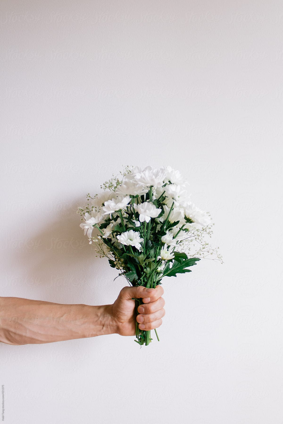 Man Holding White Flower Bouquet Stocksy United