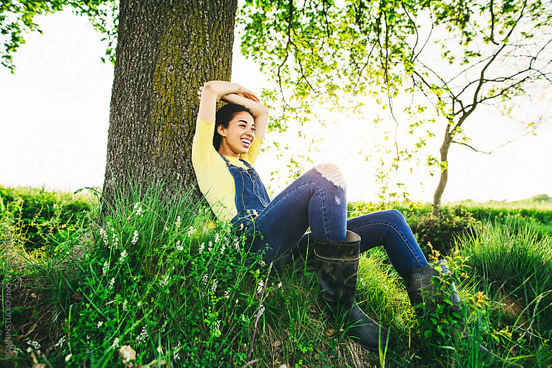 Woman relaxing in the nature at afternoon. by BONNINSTUDIO for Stocksy United
