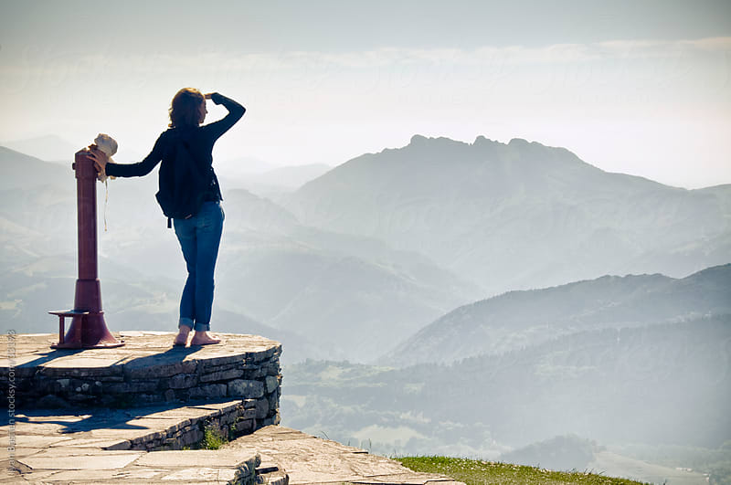 Young woman gazing at Pyrenees Mountains by Ivan Bastien for Stocksy United