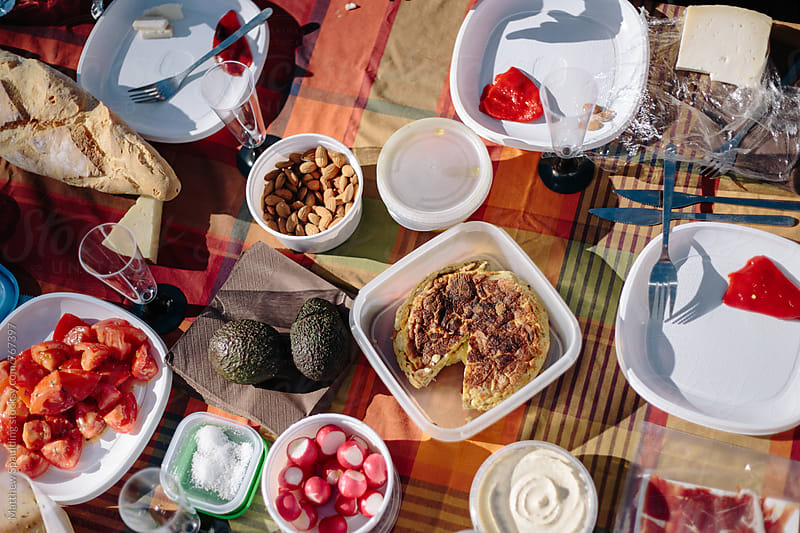 Picnic food on table outdoors by Matthew Spaulding for Stocksy United
