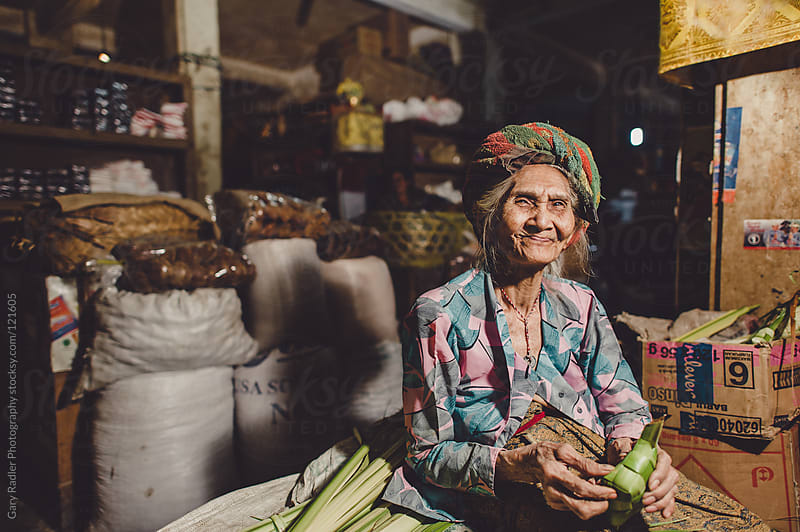 Old Woman Stall Holder in Sukawati Market, Bali. by Gary Radler Photography for Stocksy United