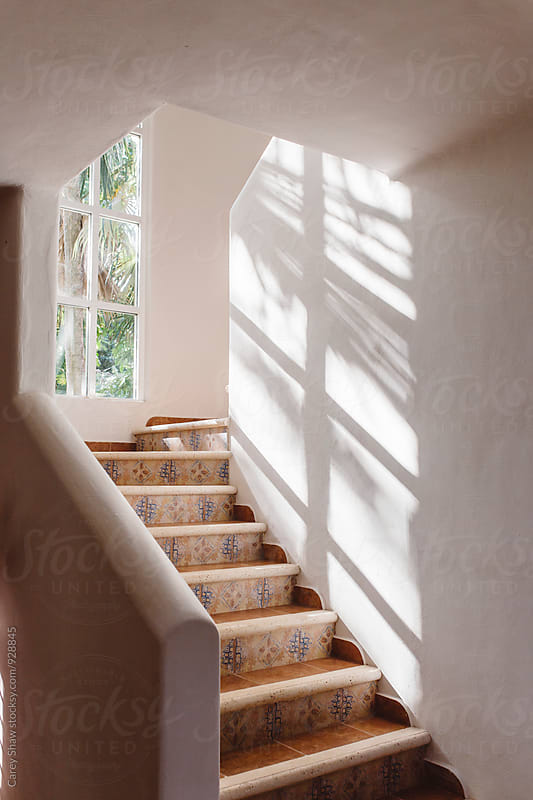 Light reflecting in white Spanish style stairwell by Carey Shaw for Stocksy United