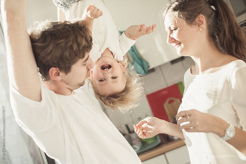 Young parents playing with their son by Irina Efremova for Stocksy United