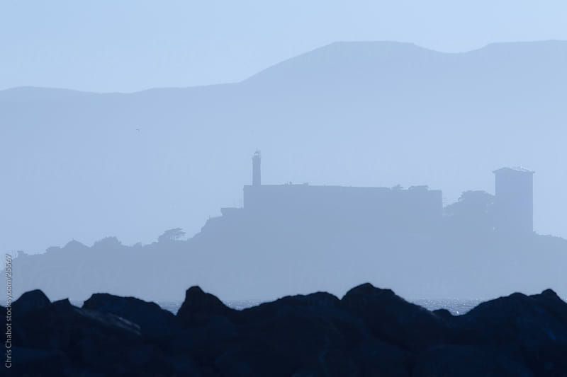 Outline of Alcatraz Island in the distance by Chris Chabot for Stocksy United