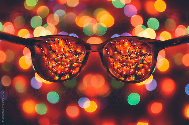 Looking Through Glasses Christmas Lights by HEX. for Stocksy United