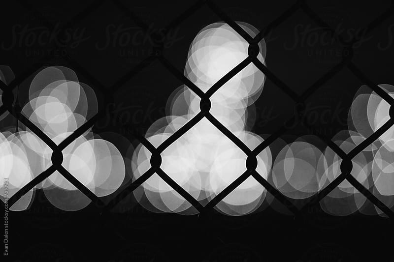 Chain Link Fence At Night by Evan Dalen for Stocksy United