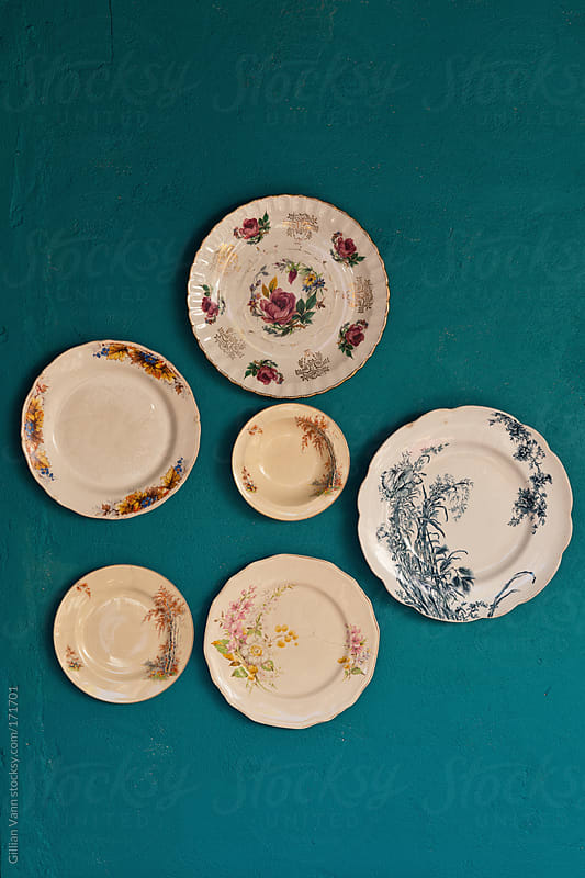 vintage plates on wall by Gillian Vann for Stocksy United