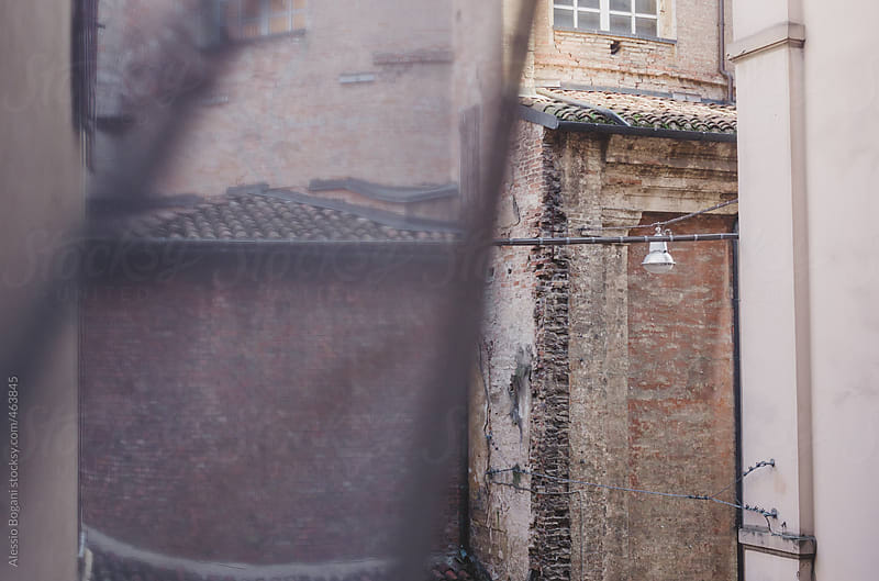 View of an old Church building from a window and curtain by Alessio Bogani for Stocksy United