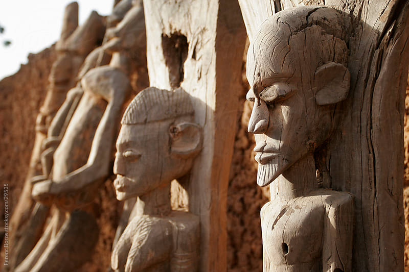 Faces of Dogon wood sculptures in Teli village, Dogon country, M by Ferenc Boros for Stocksy United