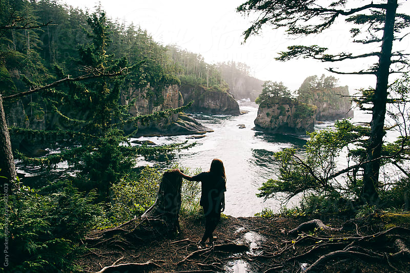 Girl overlooks a magical bay in the Pacific North West by Gary Parker for Stocksy United