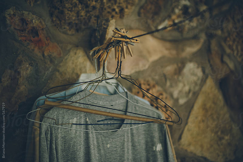 Old Shirts, Hangers, and Clothespins on a Clothesline by Briana Morrison for Stocksy United
