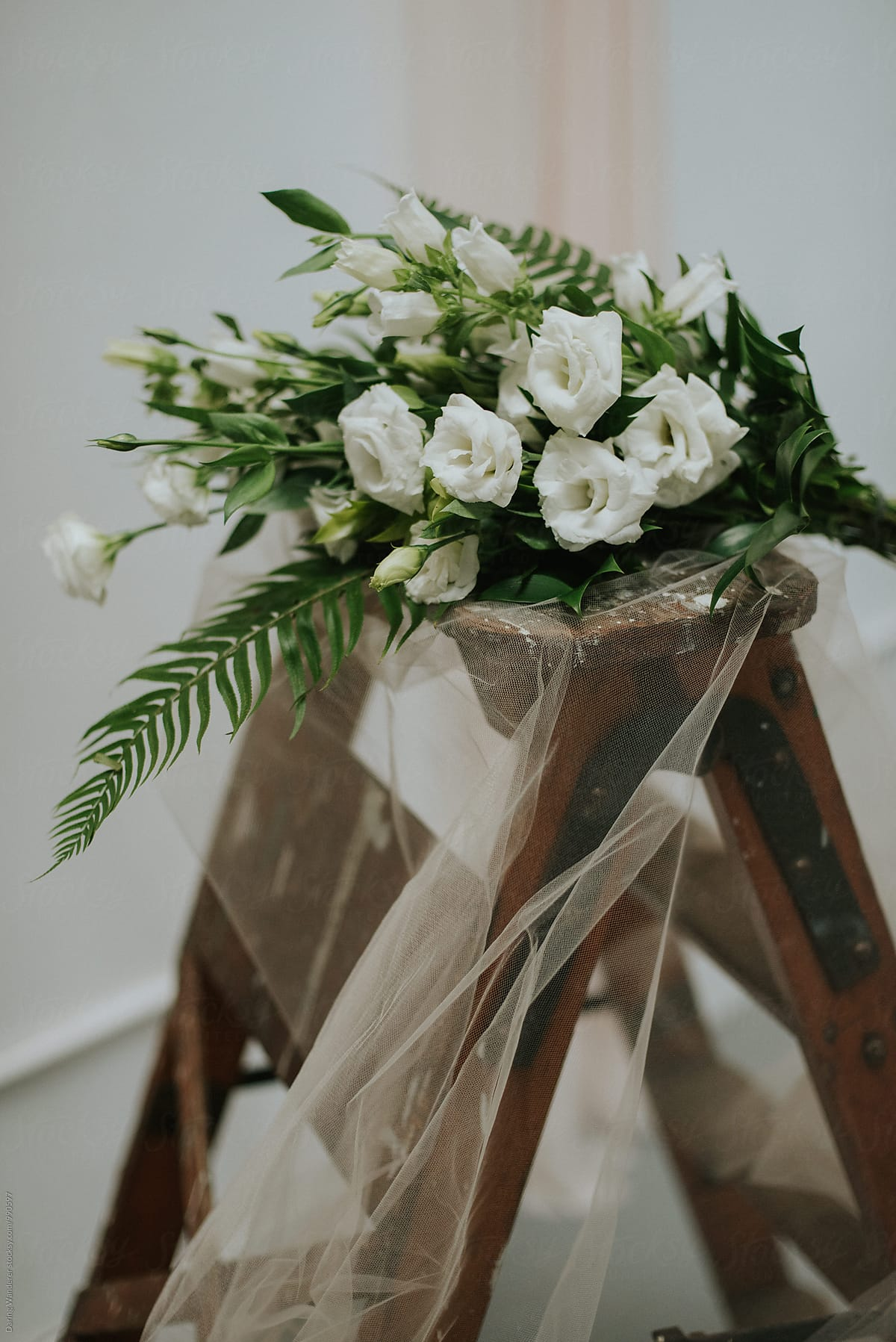 Simple Neutral White Ranunculus And Fern Flower Bouquet Stocksy United