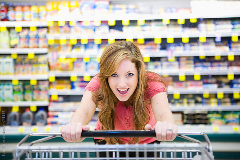 Grocery: Woman Excited to Be Shopping by Sean Locke for Stocksy United